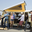 Young people by camper van — Stock Photo #33906449