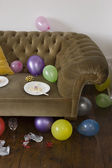 Balloons around sofa — Stock Photo