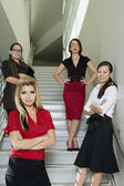 Serious Business People on Stairs — Stock Photo