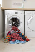 Clothes near  washing machine — Stock Photo