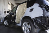 Damaged sports utility vehicle — Stok fotoğraf