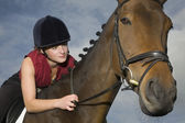 Rider holding bridle — Stock Photo