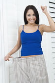 Woman satisfied with losing weight — Stock Photo