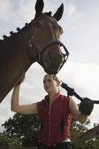 Girl grooming horse — Stock Photo