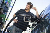 Smiling man refueling car — Stock Photo