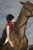 Girl on horseback — Stock Photo