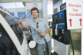 Man refueling car at natural gas station — Stock Photo