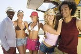 Young people by camper van — Stock Photo