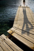 Person on jetty — Stock Photo