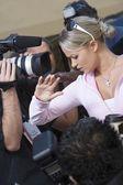 Female celebrity and paparazzi — Stock Photo