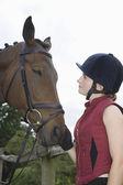 Girl holding horse — Stock Photo