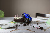 Car into cake — Stock Photo