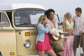 Young people with camper van — Stock Photo