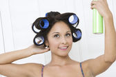 Woman applying hair spray — Stock Photo