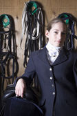 Rider posing in stables — Stock Photo