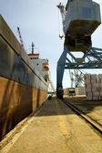 Crane loading freighter — Stock Photo