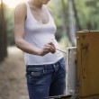 Artists stands painting on canvas in forest clearing — Stock Photo #33981979