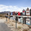 Rows of mailboxes in desert — Stock Photo #33982553