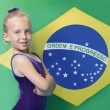 Young gymnast in front of South American flag — Stock Photo