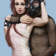 Min gas mask embracing funky woman — Zdjęcie stockowe #33982931