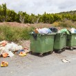 Overflowing bins next to Orange Orchard — Stock Photo #33983281