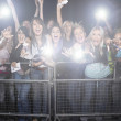 Female fans screaming and cheering — Stock Photo #33983385