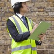 Supervisor writing notes at construction site — Stock Photo