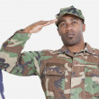 US Marine Corps soldier saluting American flag — Stock Photo #33983547