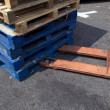 Forklift and wooden crates — Stock Photo