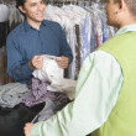 Man serving customer — Stock Photo #33984061