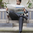 Stock Photo: Indibusinessmreading newspaper