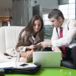 Businessman and businesswoman at meeting — Stock Photo #33985149