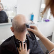 Man getting his head shaved — Stock Photo #33985367