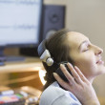 Brunette girl with headphones — Stock Photo #33985559