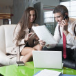 Businessman and businesswoman at meeting — Stock Photo #33985979