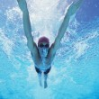Male athlete swimming in pool — Stock Photo #33986189