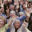 Multi-ethnic people arms raised — Stock Photo