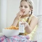 Girl eats snack — Stock Photo #33986351