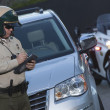 Patrol officer witing ticket — Stock Photo #33986679