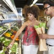Couple buying vegetables — Stock Photo #33987653