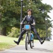 Businessman riding bicycle — Stockfoto