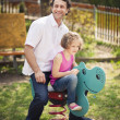 Father and daughter on playground — Stock Photo #33988733
