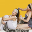 Woman combing friend's hair — Stock Photo #33988901