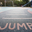 """Jump"" written into rubber floor — Stock Photo #33989903"
