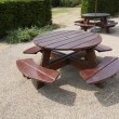 Wooden picnic tables in park — Stock Photo