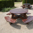 Wooden picnic tables in park — Stock Photo #33989939