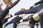 Young women stretch into ballet positions — Stock Photo