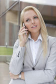Businesswoman communicating on cell phone — Stock Photo