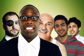 Multi-ethnic friends standing on green background — Stock Photo