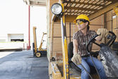 Female industrial worker driving — Stock Photo
